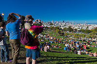 Tourists taking pictures in Mission Dolores Park, San Francisco