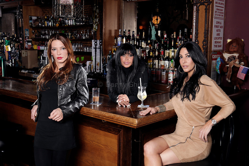 """Cast members of the VH1 reality show Mob Wives pose for a portrait at the Drunken Monkey on Staten Island. From left, Drita D'avanzo, Angela """"Big Ang"""" Raiola, and Carla Facciolo...Danny Ghitis for The New York Times"""