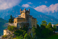Castle in Val D' Aosta, Italian Alps, Italy.Saint Pierre Castle from 12th century.Mountains of the Mount Blanc Massif beyond