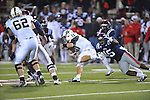Ole Miss vs. Vanderbilt quarterback Jordan Rodgers (11) is tackled by Ole Miss linebacker Joel Kight (15) at Vaught-Hemingway Stadium in Oxford, Miss. on Saturday, November 10, 2012. Vanderbilt won 27-26.