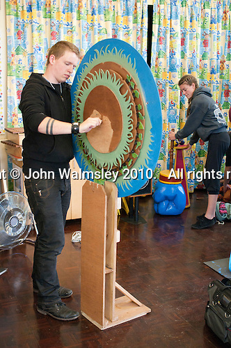 Students from Rose Bruford College set up their equipment, scenery and props before performing at a state Infant School.