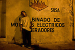 "Juan Carlos Figueroa spends his nights on a corner in Gautemala City's Zone 8. In his cupped hand he holds a ball of cloth soaked with paint thinner for huffing. Many of ""los niños de la calle,""--the children of the streets--are addicted to paint thinner, soaking balls of cloth with it and holding the toxic rags to their mouths. The children and young adults prefer solvent to glue because it is cheaper and helps them forget their hunger pains and cold. Carlos Toledo, director and founder of Nuestros Derechos--Our Rights- a Guatemalan non-governmental organization that tries to help the children off the streets and into society, said there are about 10,000 children living without homes or stable lives in Guatemala. ""These children are illegal in their own country,"" Toledo said, since most have no legal documentation and are not recognized as existing by the government."
