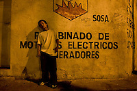 """Juan Carlos Figueroa spends his nights on a corner in Gautemala City's Zone 8. In his cupped hand he holds a ball of cloth soaked with paint thinner for huffing. Many of """"los niños de la calle,""""--the children of the streets--are addicted to paint thinner, soaking balls of cloth with it and holding the toxic rags to their mouths. The children and young adults prefer solvent to glue because it is cheaper and helps them forget their hunger pains and cold. Carlos Toledo, director and founder of Nuestros Derechos--Our Rights- a Guatemalan non-governmental organization that tries to help the children off the streets and into society, said there are about 10,000 children living without homes or stable lives in Guatemala. """"These children are illegal in their own country,"""" Toledo said, since most have no legal documentation and are not recognized as existing by the government."""
