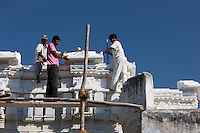 Indian builders working on a new building in Narlai village in Rajasthan, Northern India