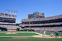 OAKLAND, CA - General stadium overall view of the Oakland Coliseum with Jose Canseco at bat during a baseball game involving the Oakland Athletics in 1997 in Oakland, California. Photo by Brad Mangin