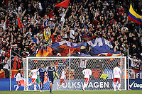New York Red Bulls fans celebrate a goal by Joel Lindpere (20) during second half stoppage time. The New York Red Bulls defeated the New England Revolution 2-0 during a Major League Soccer (MLS) match at Red Bull Arena in Harrison, NJ, on October 21, 2010.