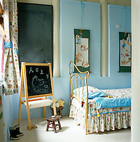 A child's bedroom has a bed with an imaginative gilded frame