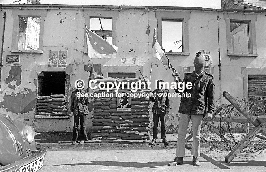 Provisional IRA members have set up a sandbag emplacement and checkpoint to regulate foot and vehicle traffic into and out of Free Derry, essentially the Bogside area of Londonderry. May 1972. 197205000294b<br />