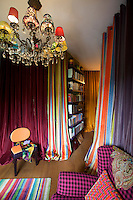 The long curtains in the study are made of a mixture of striped toile de Jouy and plain fabrics and also serve to hide Bagnara's wardrobe