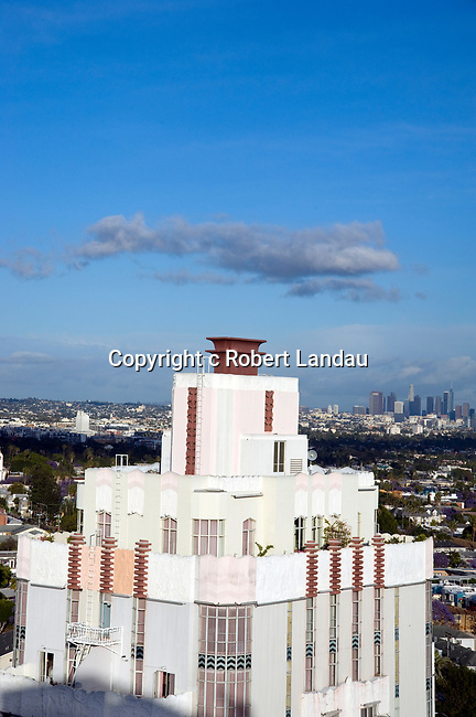 Detail of the Art Deco Sunset Tower Hotel on the Sunset Stri with Downtown Los Angeles in the background on a clear day.
