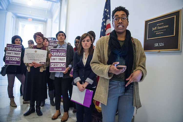 UNITED STATES - JANUARY 09: Natalie Green, a sexual assault survivor from D.C., speaks outside the Russell Building office of Sen. Jeff Sessions, R-Ala., President-elect Trump's nominee for attorney general, before delivering a poster containing the Justice Department's definition of sexual assault, January 9, 2017. The women's advocacy group UltraViolet organized the delivery to Sessions because he did not acknowledge that Trump's statements about touching women constituted sexual assault. (Photo By Tom Williams/CQ Roll Call)