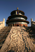 The Temple of Heaven, or Tiantan, is sometimes used as the very symbol of Beijing. The temple was visited regularly  visited by the Emperors of the Ming and Qing dynasties for annual ceremonies of prayer for good harvests. Speaking of which, the Hall of Prayer for Good Harvests is a magnificent triple-gabled circular building, 32 metres in diameter and 38 metres tall, built on three levels of marble stone base.  The building is completely wooden, using no nails in its construction.