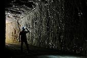 A speleologist entering an abandoned mine