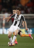 Calcio, Serie A: Roma, stadio Olimpico, 14 maggio 2017.<br /> Juventus' Stephan Lichtsteiner (r) in action with AS Roma's Stephan El Shaarawy  (l) during the Italian Serie A football match between AS Roma and Juventus at Rome's Olympic stadium, May 14, 2017.<br /> UPDATE IMAGES PRESS/Isabella Bonotto