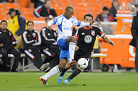 Montreal Impact midfielder Collen Warner (18) shields the ball from D.C. United forwards Dwayne De Rosario (7) D.C. United tied The Montreal Impact 1-1, at RFK Stadium, Wednesday April 18 , 2012.