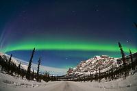 Aurora over the James Dalton Highway and Mount Sukakpak in the Brooks Mountain Range, Arctic, Alaska