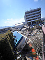 April 1st, 2011, Miyako, Japan - A fishing boat lies upside down in the parking lot of Miyako city hall, Iwate Prefecture, on April 1, 2011, three weeks after the city was devastated by a magnitude 9.0 earthquake and ensuing tsunami. The boat was apparently washed away by the tsunami from the nearby river.  (Natsuki Sakai/AFLO) [3615] -mis-.