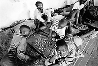 Rwanda. Gitagata. Prison for 152 children, aged 4 to 14, all convicted for active involvement (murder) in the 1994 rwandese genocide. Reeducation camp for minors. Children play the game of draughts. © 1995 Didier Ruef