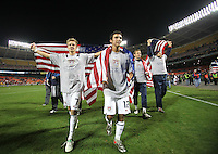 Jonathan Bornstein celebrates with Stuart Holden after 2-2 tie with Costa Rica to put the USA in first place of CONCACAF 2010 World Cup qualifying, at RFK Stadium, in Washington DC, Wednesday, October 14, 2009.