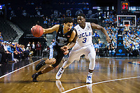 BROOKLYN, NY - Saturday December 19, 2015: Marcus Paige (#5) of North Carolina drives on Aaron Holiday (#3) of UCLA as the two square off in the CBS Classic at Barclays Center in Brooklyn, NY.