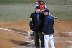 Ole Miss Head Coach Mike Bianco (5) discusses a play with home plate umpire Tony Walsh  at Oxford-University Stadium in Oxford, Miss. on Wednesday, March 9, 2010.
