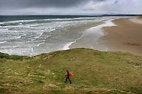 Surfers on Bundoran beach County Sligo, Ireland