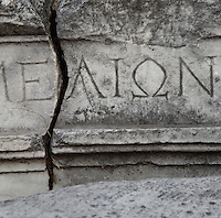 Fragment of fallen roof with an inscription in Greek in the ruins of the Homeric city of Troy, Hill of Hissarlik, Turkey. Troy was a city, both factual and legendary, in northwest Anatolia and was the setting of the Trojan Wars described in Homer's Iliad. Picture by Manuel Cohen