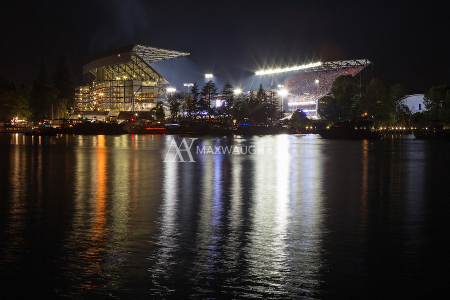 This photo was taken on Opening Night at the new Husky Stadium, during the game against the Boise State Broncos on August 31, 2013.<br /> <br /> This image is available as a Limited Edition metallic print measuring 30&quot; x 20&quot; (select the metallic print from the price options when you add to cart).  You may also purchase smaller lustre prints or license it for commercial use.<br /> <br /> *If you are interested in a large limited edition (of 10) aluminum print measuring 36&quot; x 24&quot;, please contact me.<br /> <br /> **No, the watermark will not appear on the final image!
