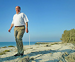 Rangers chairman John McLelland walking on the shores of the Arabian Gulf
