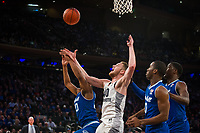 NEW YORK, NY - Thursday March 9, 2017: Luke Fischer (#40) of Marquette goes up for a shot against Desi Rodriguez (#20) of Seton Hall as the two schools square off in the Quarterfinals of the Big East Tournament at Madison Square Garden.
