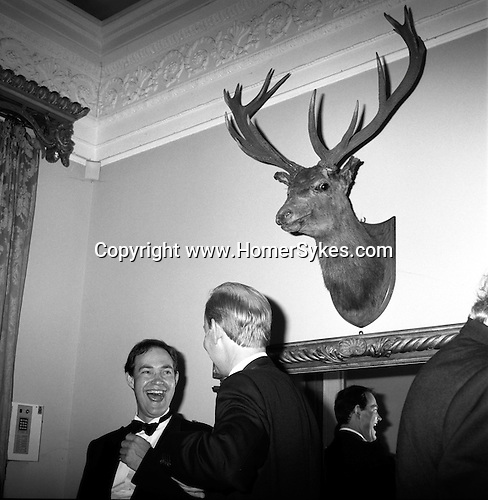The Quantock Staghounds. A mounted stags head looks down on the revellers who have spilled out of the hunt ball marquee and into Bagborough House. West Bagborough, Somerset...Hunting with Hounds / Mansion Editions (isbn 0-9542233-1-4)