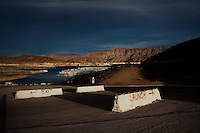 CREDIT: Daryl Peveto / LUCEO for The Wall Street Journal.Photo Assignment ID: 11416 Slug: LAKEMEAD ..Lake Mead, Nevada, March 16, 2011 - The expansive boat launch at Echo Bay on Lake Mead had to be relocated when the water became too low to extend it further. Lake Mead has been one of America's most popular recreation areas, with a 12-month season that attracts more than 9 million visitors each year for swimming, boating, skiing, fishing and other outdoor pursuits. Currently it is experiencing a 10 year drought that has diminished the water to levels not seen since the lake was created. ..Lake Mead is the largest water reservoir in the United States. Located on the Colorado River southeast of Las Vegas, it is the major reserve for Nevada, California and Arizona. The city of Las Vegas alone gets 90% of its water from Lake Mead. The lake is currently experiencing a ten year drought, recently dropping to1,083 feet - its lowest level since it was dammed in the 1930s. If it drops further, there is the potential for cutoffs of water for hydro-electricity, agriculture and cities across the Southwest. The current level is near emergency level: if drops to 1075, the Secretary of Interior will have to declare a severe water emergency and major cutbacks will ensue. If gets below 1025, all water for hydro from Hoover Dam shut off. If it falls below 1,000 feet the intake valves that pull water from the Lake for consumption will no longer be operational.