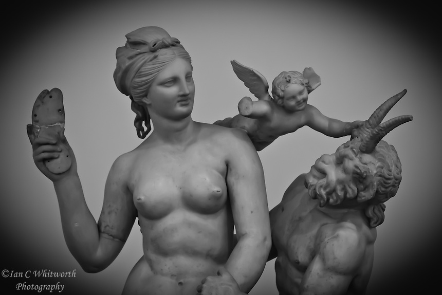 Statue of Venus Eros and Pan at a museum in Athens