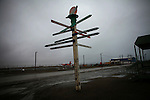 A sign in Barrow, Alaska - the northernmost point in the United States - points to lands far and near.