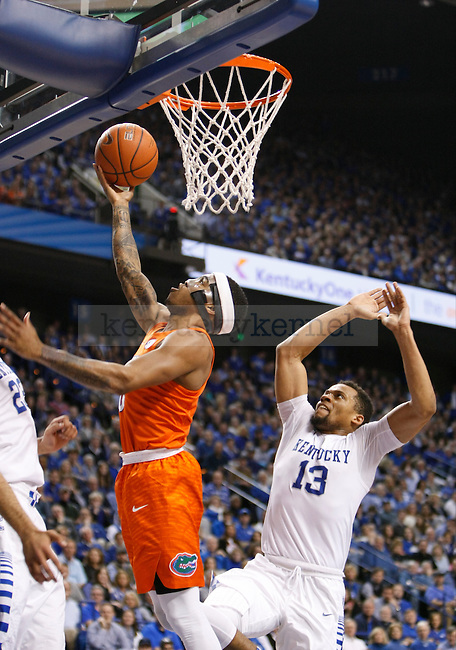 Florida guard Kasey Hill (0) goes up for a layup with UK guard Isaiah Briscoe (13) going up for the block during the UK Men's Basketball vs. Florida Gators game at Rupp Arena. Saturday, February 6, 2016 in Lexington, Ky. UK defeated Florida 80 - 61