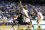 08 November 2013: High Point's Allan Chaney (13) is defended by UNCG's RJ White (34) and UNCG's Nicholas Paulos (right). The University of North Carolina Greensboro Spartans played the High Point University Panthers in a 2013-14 NCAA Division I men's college basketball game at the Greensboro Coliseum in Greensboro, North Carolina. UNCG won the game 82-74.