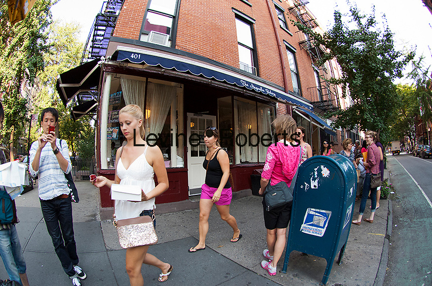 "The Magnolia Bakery located in Greenwich Village in New York on Thursday, September 13, 2012. The popular bakery known for their cupcakes was featured in the ""Sex and the City"" television program.  (© Frances M. Roberts)"