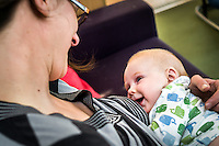 A baby smiles at its mother while breastfeeding.<br /> <br /> 04/05/2011<br /> Hampshire, England, UK