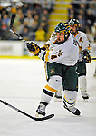 16 November 2008: University of Vermont Catamount defenseman Patrick Cullity, a Junior from Tewsbury, MA, in action against the Merrimack College Warriors at Gutterson Fieldhouse, in Burlington, Vermont. The Catamounts defeated the Warriors 2-1 in front of a near-capacity crowd of 3,813...Mandatory Photo Credit: Ed Wolfstein Photo