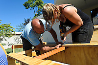 Andy Chaggar and a volunteer constructing desks for a home school at an orphanage supported by EDV, Port-au-Prince, Haiti. EDV is committed to affecting permanent change in disaster-affected communities worldwide. Their role is to facilitate personal connections between volunteers and the survivors of disasters.  The charity is based on a proven model developed by several landmark organisations that have paved the way for citizens to become disaster volunteers. These landmark organisations have shown that supposedly ordinary people working together with the guidance of knowledgeable leaders can make an extraordinary difference in the lives of those affected by disaster..EDV believe that to provide meaningful relief and reconstruction assistance to disaster affected communities they have to do more than reconstruct buildings. They need to understand and address the factors that made a community vulnerable to the disaster in the first place. The charity's work is organised with these factors in mind so that they can affect change that far outlives their presence..EDV believes that survivor motivation is essential to the recovery of any disaster-affected community. Their operations will always be predicated on the idea that survivors may be traumatised, but they are not helpless. With this in mind, EDV encourages host communities to direct their own recovery. EDV believe that this empowerment is essential in helping survivors feel a renewed sense of control over their lives which will, in turn, help overcome the feelings of hopelessness that can follow a disaster and inhibit long term recovery. EDV also believe that social cohesion is of primary importance in any disaster-affected area. No amount of bricks or mortar will bring about sustainable improvement if communities fail to come together or are disrupted by relief efforts. Therefore, their operations will always aim to foster communication and cooperation within and between the communities they serve.