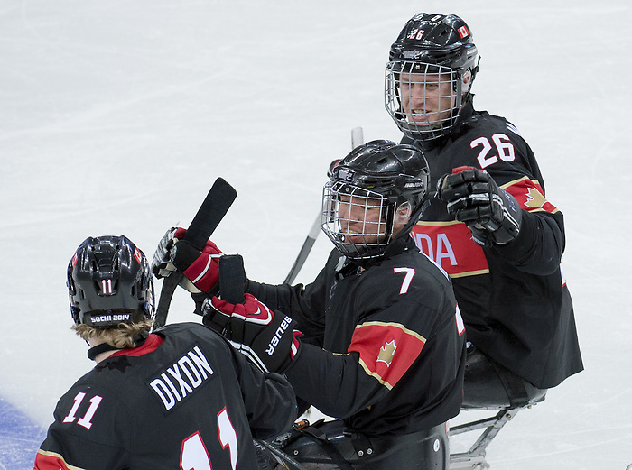 Sochi, RUSSIA - Mar 9 2014 -  Adam Dixon and Dominic Larocque congratulate Marc Dorion (middle) on his goal Canada vs. Norway at the 2014 Paralympic Winter Games in Sochi, Russia.  (Photo: Matthew Murnaghan/Canadian Paralympic Committee)