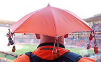 A Denmark supporters  keeps dry and in the shade while watching the action at Soccer City in Johannesburg, South Africa on Monday, June 14, 2010.