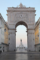 Triumphal arch on the Rua Augusta, built to commemorate the city's reconstruction after the 1755 earthquake, with the Placa do Commercio or Commerce Square behind, Lisbon, Portugal. Seen through the arch is the equestrian statue of  King Jose I trampling on snakes, 1775, by Machado de Castro. Picture by Manuel Cohen