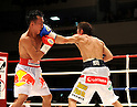 (L-R) Pornsawan Porpramook (THA), Akira Yaegashi (JPN), OCTOBER 24, 2011 - Boxing : Akira Yaegashi of Japan hits Pornsawan Porpramook of Thailand during the eighth round of the WBA minimumweight title bout at Korakuen Hall in Tokyo, Japan. (Photo by Mikio Nakai/AFLO)