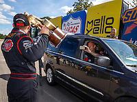Aug 21, 2016; Brainerd, MN, USA; NHRA  top alcohol funny car driver Jonnie Lindberg celebrates with crew members after winning the Lucas Oil Nationals at Brainerd International Raceway. Mandatory Credit: Mark J. Rebilas-USA TODAY Sports