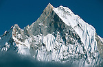 Machapuchare 6993m (22,943ft), West Face from Annapurna Base Camp, Nepal.  Sacred to the god Shiva, the peak is forbidden to climbers, and has never officially been summited.  It is commonly known as the &quot;Matterhorn of Nepal&quot; or the &quot;Fish's Tail&quot;.  Nikon F90, 80-200/2.8, Agfa CT100.  Photo: 2 November 1993.