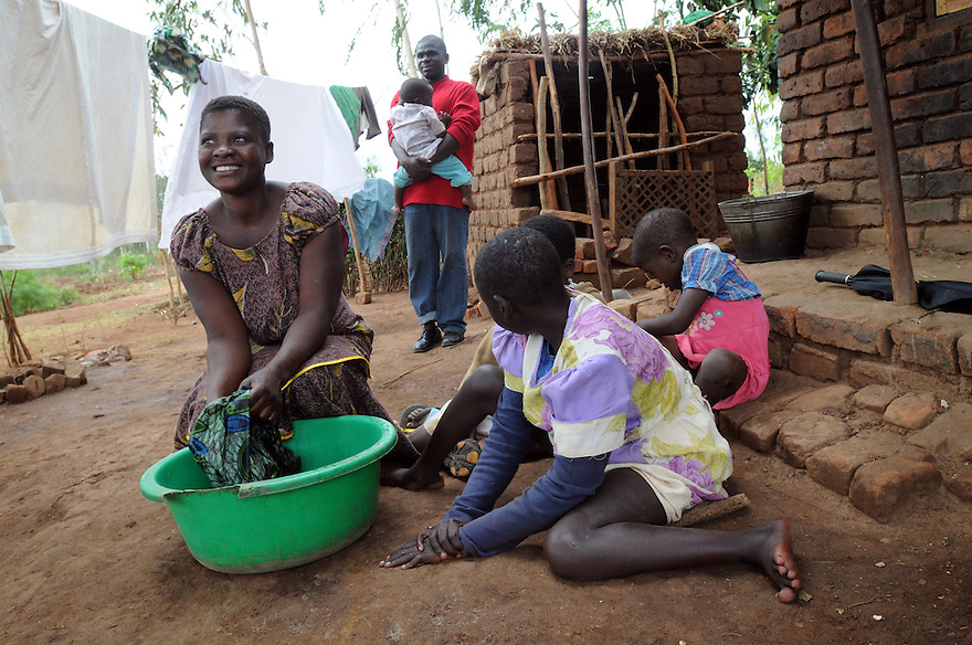 BERTHA CHIKAOUDA WHO LIVES IN THE VILLAGE OF KASARIKA, NEAR LUCHENZA, MALAWI WITH HER FAMILY. HUSBAND GOMESI, 37, DANIEL, 1, MONICA, 9, EMMA, 7 AND CAROLINE, 13, (WHO IS HANDICAPPED). KASARIKA IS AN AIDS COMMUNITY WHICH CARES FOR 45 AIDS WIDOWS AND 111 AIDS ORPHANS. PICTURE BY CLARE KENDALL. 2/11/12