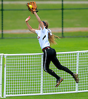 Gary Cosby Jr./Decatur Daily      Hartselle's Sarah Ellen Battles steals a home run as she leaps over the fence to make a catch against Valley during the opening round of the state softball tournament at Lagoon Park in Montgomery Thursday morning.