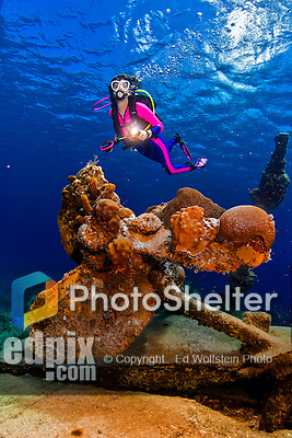21 June 2016: SCUBA Diver Sally Herschorn swims over the coral encrusted propellor at the Wreck of the Balboa, a Norwegian freighter which sunk in 1932 off George Town Harbour of Grand Cayman Island. Located in the British West Indies in the Caribbean, the Cayman Islands are renowned for excellent scuba diving, snorkeling, beaches, banking, and tourism.  Mandatory Credit: Ed Wolfstein Photo *** RAW (NEF) Image File Available ***