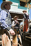 Cowboys await the start of saddle bronc riding competition.  Mareeba Rodeo, Mareeba, Queensland, Australia